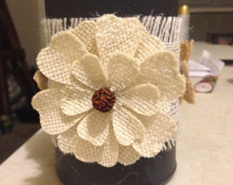 Small tin can with burlap ribbon and flower