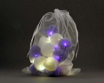 20 pom-pom LED fairy lights in white and lilac pom-poms.