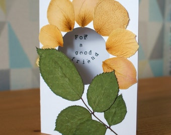 """Handmade """"For a good friend"""" card with rose petals and leaves"""
