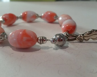 Colourful Easter Beaded Bracelet: acrylic Easter egg beads, silver Easter bunny charm and silver features.
