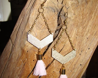 Golden earrings and pink Pompom