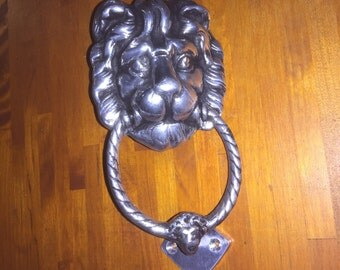 Polished Lion Head Door Knocker.