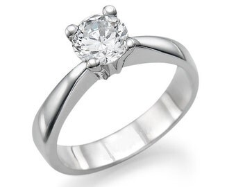 Solitaire ring in 14 k White Gold with central diamond 0.50 CT