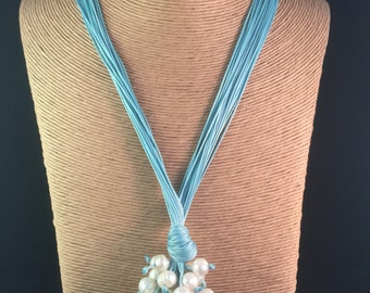 Long light blue pearl cluster necklace