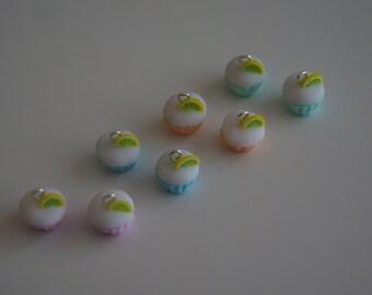 Miniature Cupcake with A Slice of Lemon