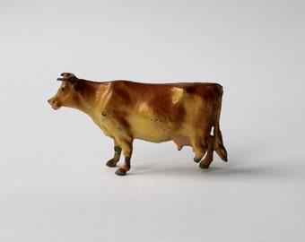 Vintage antique diecast, iron cast, lead toy farm animal tan Cow. Britains lead  tan toy cow.