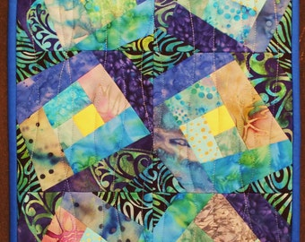 Table mat in blue batiks