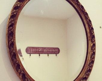 Gold wall mirror, gilt vintage mirror, oval wall mirror, ornate vintage mirror.