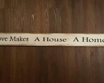 Pallet wood sign Love makes a house a home