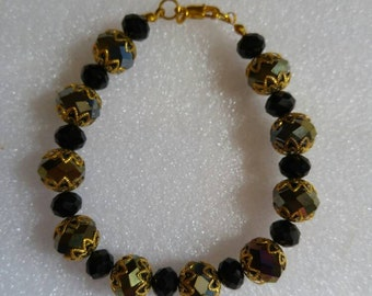 Smokey Quartz accented with black and gold beaded bracelet