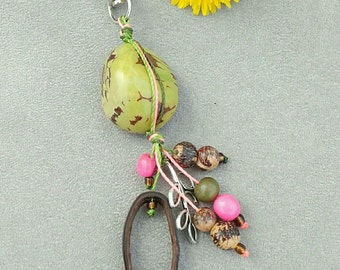 "Key nature and original ""tagua"" nuts and seeds of acai"