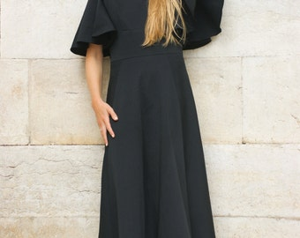 Black maxi-dress with angel sleeves.