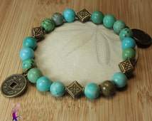Turquoise bracelet with bronze metal chinese coins charms