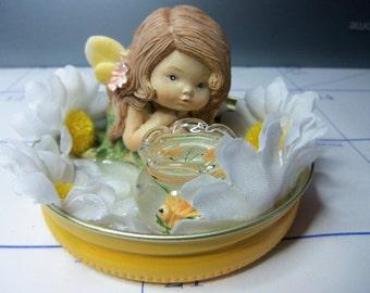 Baby Fairy and goldfish bowl