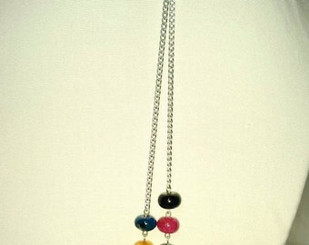 L- O- N-G silver tone chain accented with 4 bead combinations on each end   #56