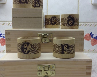 Wooden napkin rings initialled with pyrography