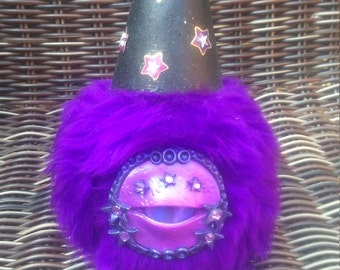 Furry, polymer clay eyed monster aret doll