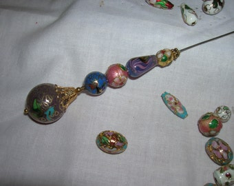 This hat pin is made in the vintage style with a very large closionne bead at the top