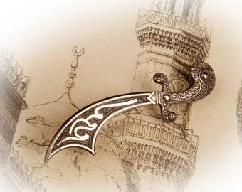 Silver oriental sword brooch