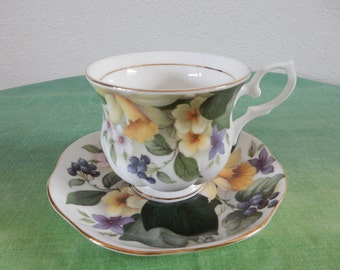 Cup and saucer with bright spring motif
