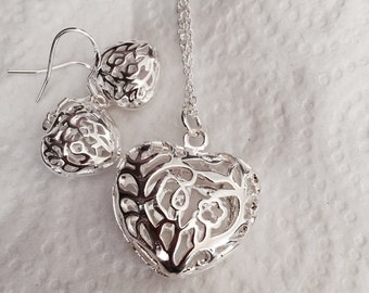 Heart shaped pendant and matching earrings