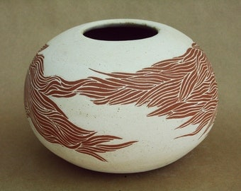 red and white vase.