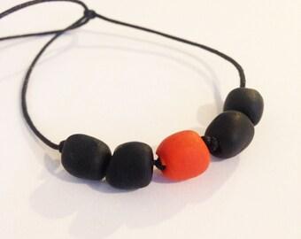 Black and orange clay bead bracelet