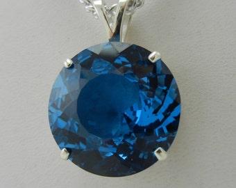 32.1 ct. Swiss Blue Topaz Round Pendant