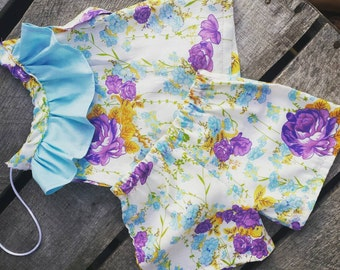 Size 6/9 months purple floral top and shorts