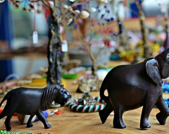 Wooden animals figures (lion and elephant)