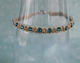 Cord bracelet with blue glass beads