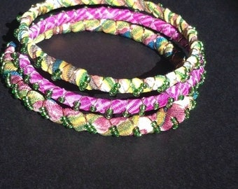 Fabric wrapped bangles, yellow, purple, green, seed beads