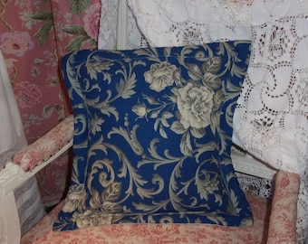 A cushion made of old fabric, roses patterns