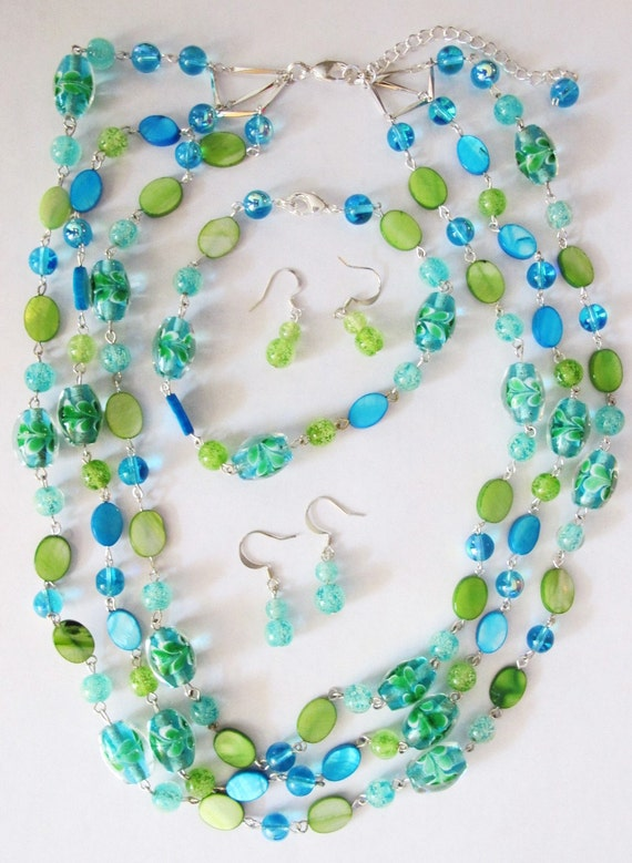 Stylish, glow-in-the-dark blue and green glass bead necklace, bracelet, duel earring set.