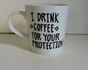 I drink coffee for your protection coffee mug