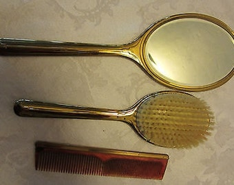 Antique mirror and Comb