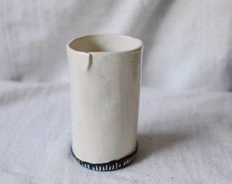 white vase with lines