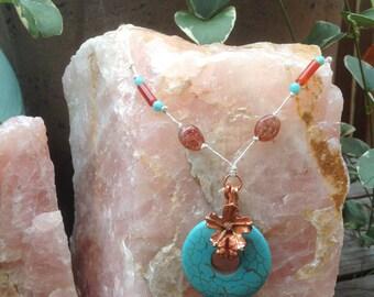 Gemstone donut necklace.