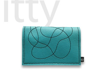 The wallet called itty (shown in TURQUOISE)
