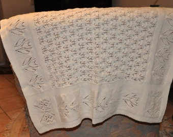 Hand knitted baby blanket / cream colours