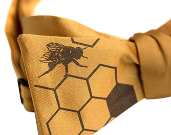 "Bee Hive Bow Tie. Honey Bee Print. Mustard yellow bow tie, self tie. ""Oh Honey."" Silkscreened honeybees. Chocolate brown print."