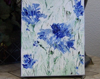 Blue and white semi abstract flowers painted in oil impasto style