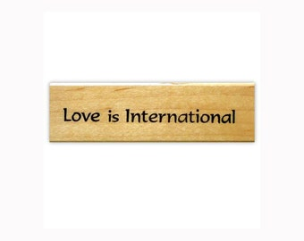 Love is International mounted rubber stamp, world peace, global sentiment, Sweet Grass Stamps No.3
