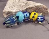 Handmade Lampwork Beads by Monaslampwork - Elongated Triangle Focal with Friends - Lampwork Glass Beads by Mona Sullivan Organic Tribal Boho