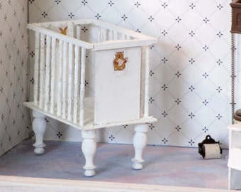 Miniature old-fashioned child's crib white