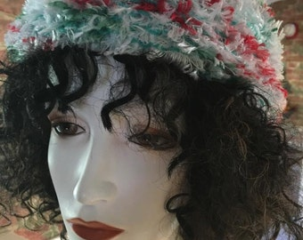 Red, green ad white fuzzy hand knitted hat