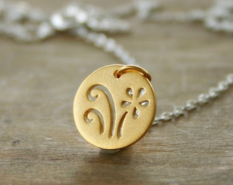 Gold daisy necklace on sterling silver chain. Mixed metals. Flower charm necklace. Cutout abstract jewelry.