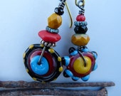 Asymmetrical Lampwork Disc Earrings in Black, Red, Yellow and Turquoise