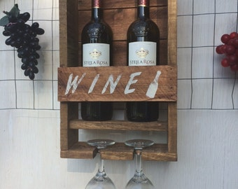 Wine Bottle rack, holds 2 bottles of wine and 2 wine glasses. Made from Pallett wood, reclaimed, repurposed. Wall decor.purpused wood.
