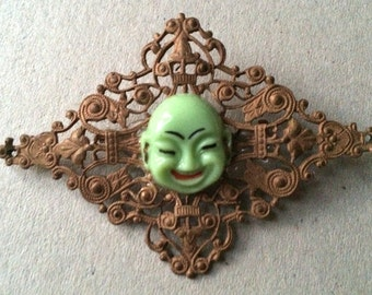 Vintage 20's Painted Porcelain Buddha Head on a Victorian Patina Brass Filigree Pin, Brooch